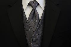 黑色银色关系无尾礼服背心 库存照片