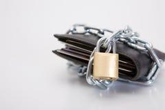 黑色锁着的钱包 库存图片