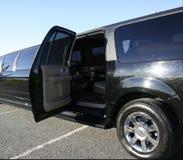 黑色门大型高级轿车开放舒展 免版税图库摄影