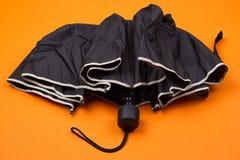 黑色闭合的伞 库存照片