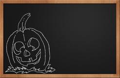 黑色黑板万圣节南瓜微笑 免版税库存照片
