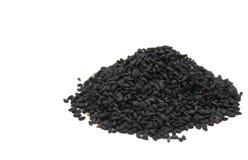 黑色nigella漂白亚麻纤维的种子 库存照片