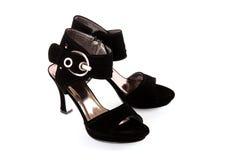 黑色s穿上鞋子妇女 库存照片