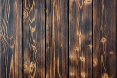 黑褐色掠过了被烧的木板条纹理 库存图片