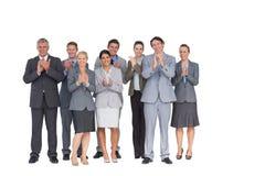 鼓掌在照相机的微笑的企业队 免版税库存照片