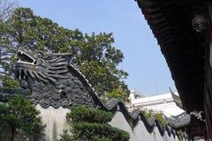 龙墙壁在Yu庭院 图库摄影