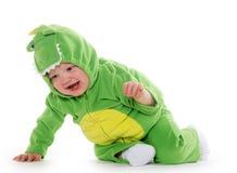 龙服装的男婴 免版税库存图片