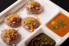 龙爪稷Idli,是南印度的一个美味蛋糕 库存图片