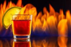 龙舌兰酒小玻璃和火 图库摄影