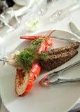 龙虾用乳脂状的调味汁 免版税库存图片