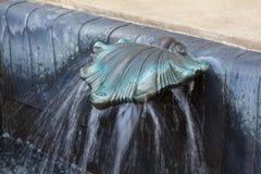 水龙头由古铜制成以壳的形式 图库摄影