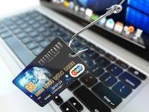 ?redit卡片phishing的概念 有信用卡和膝上型计算机的c勾子 免版税库存图片