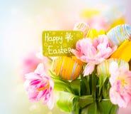 Δέσμη λουλουδιών διακοπών Πάσχας με τη ευχετήρια κάρτα Στοκ Εικόνες