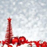 Διακοσμήσεις Χριστουγέννων με το αστράφτοντας υπόβαθρο Στοκ Εικόνα