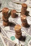 Δολάρια και σεντ Στοκ Φωτογραφίες