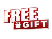 Δωρεάν δώρο με το παρόν σύμβολο κιβωτίων στο κόκκινο άσπρο έμβλημα - επιστολές Στοκ φωτογραφία με δικαίωμα ελεύθερης χρήσης