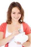 девушка банка держа piggy подростковое Стоковое Изображение