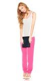 Девушка в рубашке и брюках с планшетом Стоковая Фотография RF