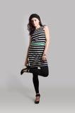Девушка в striped тунике Стоковые Изображения
