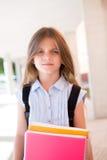 Девушка держа книги Стоковая Фотография