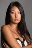 Девушка детенышей довольно азиатская Стоковые Изображения RF