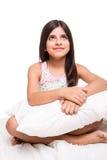 Девушка обнимая подушку Стоковая Фотография