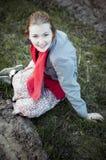 Девушка сидя на том основании Стоковые Фотографии RF