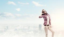 Девушка с наушниками Стоковая Фотография RF