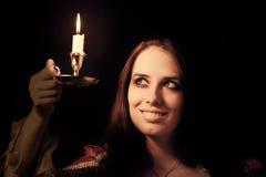 Девушка с свечой Стоковая Фотография