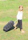 Девушка с чемоданом Стоковые Изображения RF