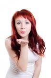 Девушка дует что-то с рукой Стоковая Фотография