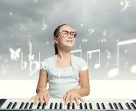 Девушка школы с роялем Стоковые Фото