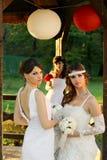 Девушки в платьях свадьбы Стоковая Фотография RF