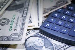 Деньги и чалькулятор Стоковая Фотография