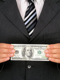 деньги удерживания бизнесмена Стоковые Фотографии RF