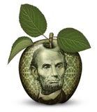 Деньги Яблоко Стоковое фото RF