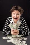 деньги девушки счастливые Стоковая Фотография