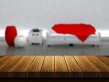 Деревянный стол с интерьером комнаты в предпосылке Стоковое Изображение RF