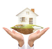 Держать дом представляя владение недвижимостью Стоковое Изображение RF