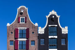 Деталь 2 голландских домов канала в Амстердаме Стоковое Фото