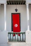Деталь Medina в Sousse, Тунисе с флагом Стоковая Фотография