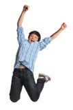 детеныши мальчика скача Стоковые Изображения