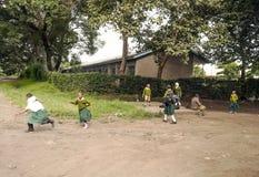 Дети играя в улице Стоковое Фото