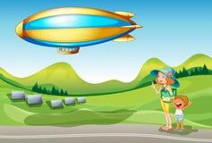 Дирижабль около холмов Стоковые Фотографии RF