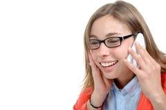 Довольно молодая секретарша использует его мобильный телефон в его офисе Стоковые Изображения