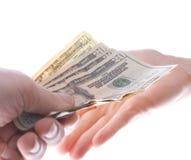 доллары давать Стоковая Фотография