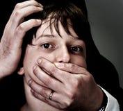 домогательство злоупотреблением Стоковое фото RF