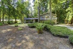 Дом в древесинах Временя в штате Вашингтоне Стоковые Изображения