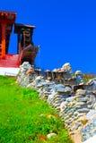 Дом старого стиля с водяной мельницей Стоковое Фото