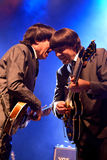 Дорога аббатства (дань диапазона к Beatles) выполняет на золотом возрождении Стоковая Фотография